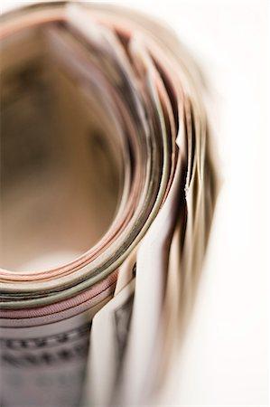 Roll of dollar bills Stock Photo - Premium Royalty-Free, Code: 6102-06336993