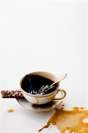 spot (dirt mark) - High angle view of spilled black coffee Stock Photo - Premium Royalty-Free, Code: 6102-06337098
