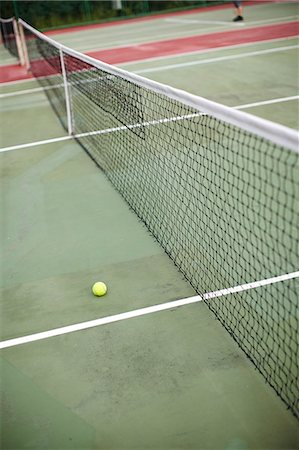 High angle view of net and tennis ball Stock Photo - Premium Royalty-Free, Code: 6102-06337034