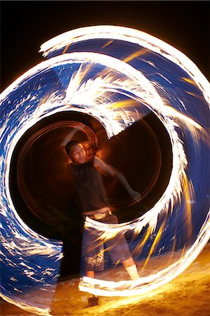 Man dancing with fire on beach Stock Photo - Premium Royalty-Free, Code: 6102-06337035