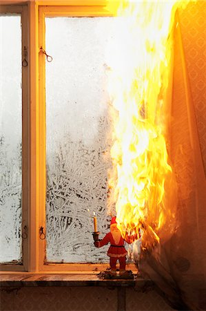 dangerous accident - Burning curtain at home Stock Photo - Premium Royalty-Free, Code: 6102-06337038
