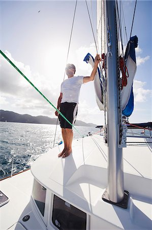 Man standing on sailing boat Stock Photo - Premium Royalty-Free, Code: 6102-06337124