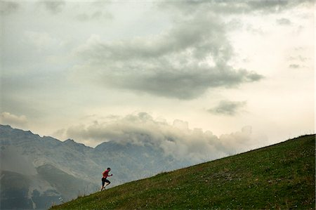fantastically - A man jogging in the mountains, Italy. Stock Photo - Premium Royalty-Free, Code: 6102-06470312