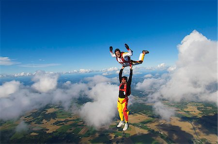 Parachute jumpers in the sky, Sweden. Stock Photo - Premium Royalty-Free, Code: 6102-06470611