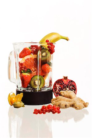 snack - Fruits in blender, studio shot Stock Photo - Premium Royalty-Free, Code: 6102-06471190