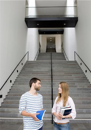 Young students with stairs in background Stock Photo - Premium Royalty-Free, Code: 6102-06471234