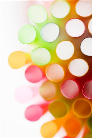 Studio shot of colorful drinking straws Stock Photo - Premium Royalty-Free, Code: 6102-06777579
