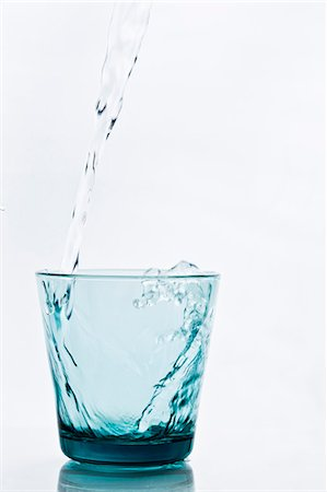 Pouring water into glass Stock Photo - Premium Royalty-Free, Code: 6102-06777595