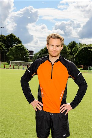 soccer player (male) - Portrait of male athlete standing on field Stock Photo - Premium Royalty-Free, Code: 6102-06777709