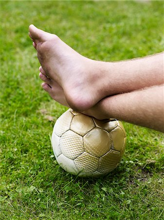 Bare foot on soccer ball Stock Photo - Premium Royalty-Free, Code: 6102-06965487