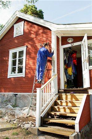 diy or home improvement - Young man repairing facade Stock Photo - Premium Royalty-Free, Code: 6102-06965428