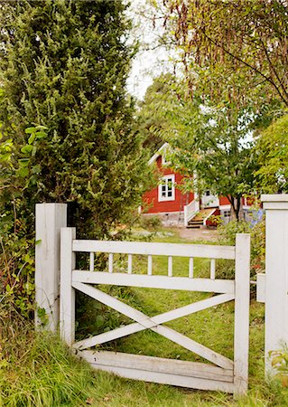 stockholm - Wooden gate with red cottage in background Stock Photo - Premium Royalty-Free, Code: 6102-06965435