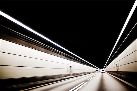 Cars driving through tunnel Stock Photo - Premium Royalty-Free, Code: 6102-06965609