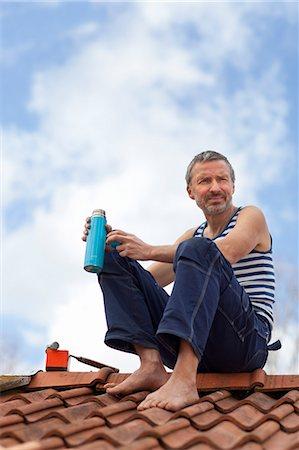 Mature man having coffee break on top of roof Stock Photo - Premium Royalty-Free, Code: 6102-07158141