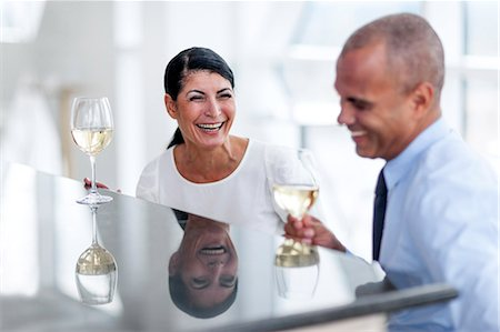 flirting - Man and woman drinking wine and talking Stock Photo - Premium Royalty-Free, Code: 6102-07158235