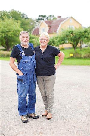 Senior couple standing together Stock Photo - Premium Royalty-Free, Code: 6102-07158355