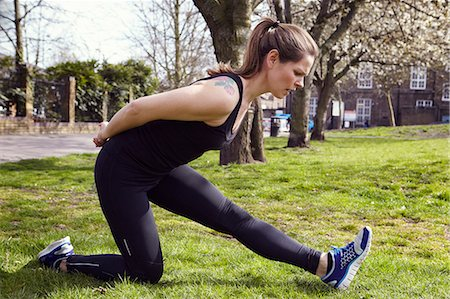 sports - Young woman in sports clothes stretching in park Stock Photo - Premium Royalty-Free, Code: 6102-07158370
