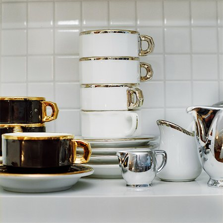 Cups on shelf Stock Photo - Premium Royalty-Free, Code: 6102-07455709