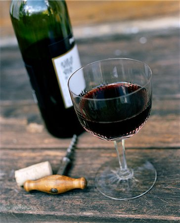 High angle view of red wine in glass and corkscrew Stock Photo - Premium Royalty-Free, Code: 6102-07455738