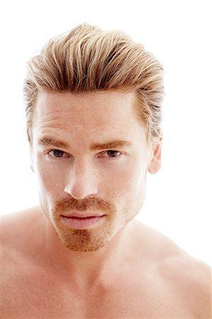 shirtless men - Portrait of young man, studio shot Stock Photo - Premium Royalty-Free, Code: 6102-07455835