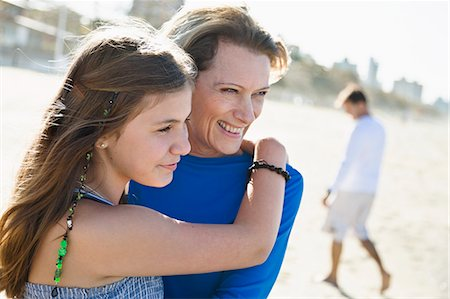 Mother with daughter on beach Stock Photo - Premium Royalty-Free, Code: 6102-07521598