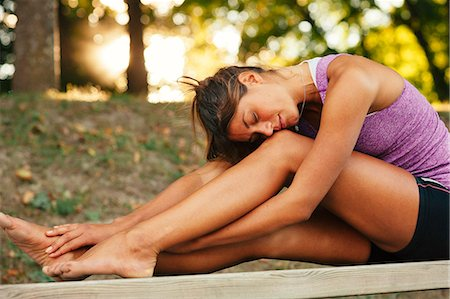 Young woman stretching, Uppsala, Sweden Stock Photo - Premium Royalty-Free, Code: 6102-07602606