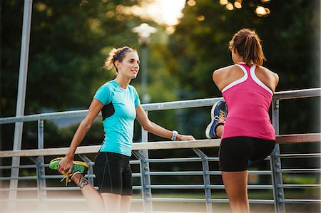 exercising - Female runners stretching, Uppsala, Sweden Stock Photo - Premium Royalty-Free, Code: 6102-07602611