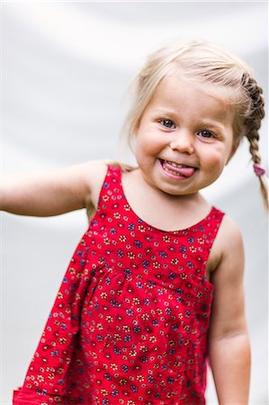 Portrait of smiling girl, Sweden Stock Photo - Premium Royalty-Free, Code: 6102-07602796