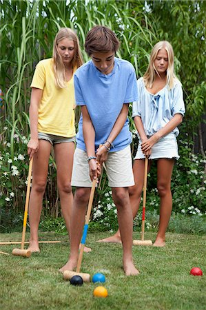 Teenager playing croquet Stock Photo - Premium Royalty-Free, Code: 6102-07602733