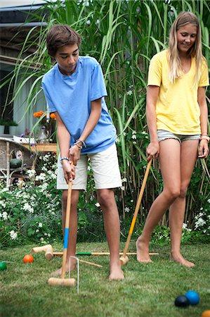 Teenager playing croquet Stock Photo - Premium Royalty-Free, Code: 6102-07602734