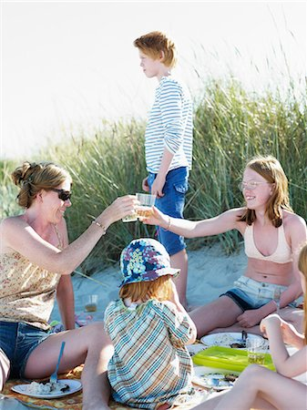 five - Family having picnic, Skane, Sweden Stock Photo - Premium Royalty-Free, Code: 6102-07602738