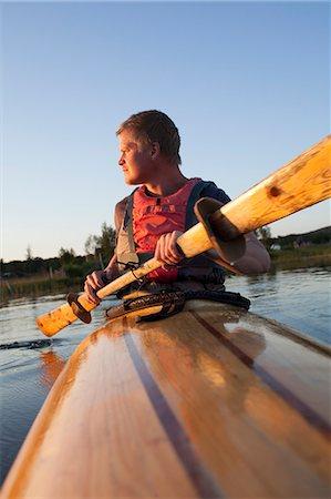 Young man kayaking, Sweden Stock Photo - Premium Royalty-Free, Code: 6102-07602872