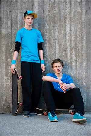 Two teenage boys against concrete wall, Stockholm, Sweden Stock Photo - Premium Royalty-Free, Code: 6102-07768454