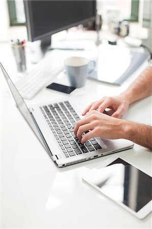 Close-up of man typing on laptop, New Jersey, USA Stock Photo - Premium Royalty-Free, Code: 6102-07768481