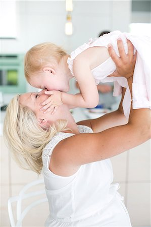 pregnant women kissing - Pregnant woman playing with daughter, Stockholm, Sweden Stock Photo - Premium Royalty-Free, Code: 6102-07768665