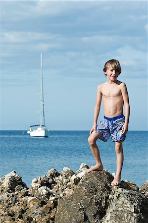 Boy on top of rock, Sicily, Italy Stock Photo - Premium Royalty-Free, Code: 6102-07768765