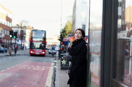 Young woman standing on bus stop Stock Photo - Premium Royalty-Free, Code: 6102-07768841