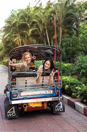 Young women in rickshaw, Bangkok, Thailand Stock Photo - Premium Royalty-Free, Code: 6102-07768959