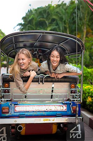 Young women on rickshaw, Bangkok, Thailand Stock Photo - Premium Royalty-Free, Code: 6102-07768960