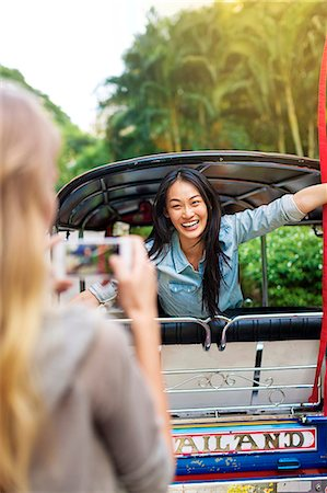 Young woman in rickshaw, Bangkok, Thailand Stock Photo - Premium Royalty-Free, Code: 6102-07768962