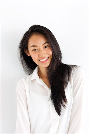 Portrait of smiling young woman Stock Photo - Premium Royalty-Free, Code: 6102-07768911