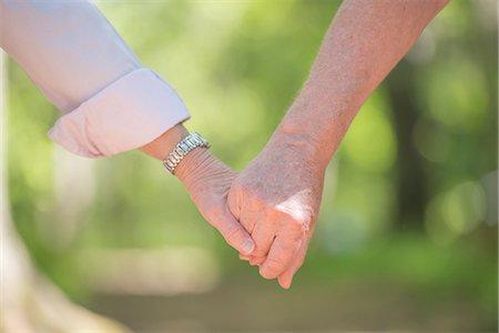 Senior couple holding hands, close-up Stock Photo - Premium Royalty-Free, Code: 6102-07769274