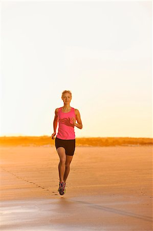 forward - Woman running on beach at dusk Stock Photo - Premium Royalty-Free, Code: 6102-07769355