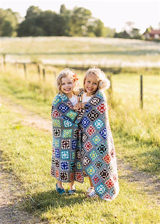 sister - Two girls wrapped together in blanket Stock Photo - Premium Royalty-Free, Code: 6102-07769468