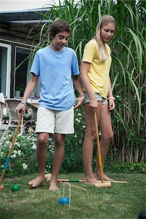 Teenagers playing croquet in garden, Sweden Stock Photo - Premium Royalty-Free, Code: 6102-07789510