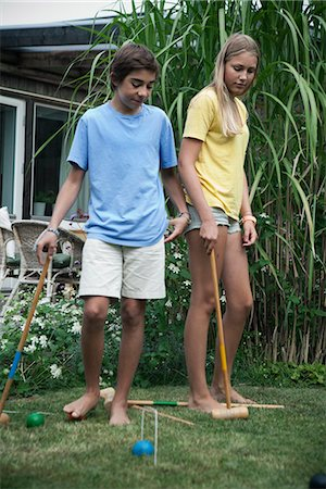 Teenagers playing croquet in garden, Sweden Stock Photo - Premium Royalty-Free, Code: 6102-07789510