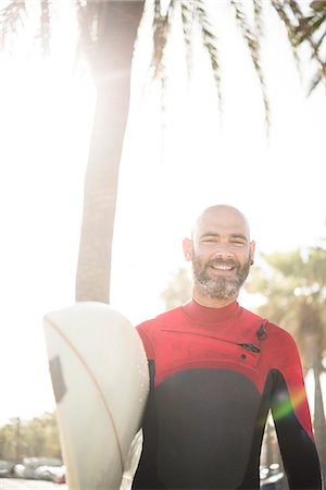day - Mature man with surfboard Stock Photo - Premium Royalty-Free, Code: 6102-07789651