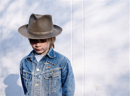 Boy wearing hat Stock Photo - Premium Royalty-Free, Code: 6102-07789661