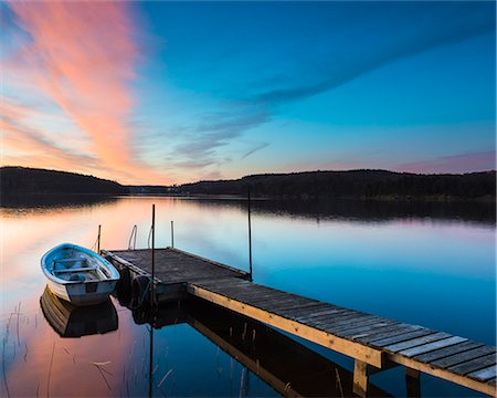 Rowing boat moored at jetty Stock Photo - Premium Royalty-Free, Code: 6102-07789980