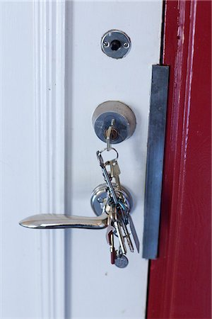 Keys in lock Stock Photo - Premium Royalty-Free, Code: 6102-07790144